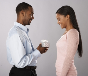 A Man Giving Gift to a Woman